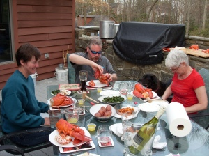Kathy, Bradley, and Uli contemplate their lobster dinners