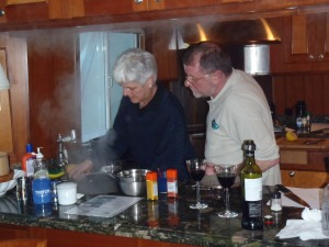 Uli and Erwin in galley preparing gourmet meal