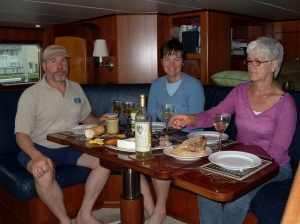 Bradley, Kathy, and Uli ready for lunch in the pilothouse