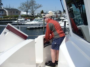 Captain Bradley brings us alongside the dock - steering from the outside helm station