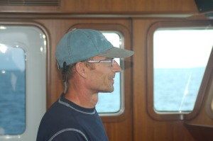 John in the Pilot House of Shear Madness