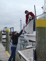 04 Leanne and Lisa (from Jarrett Bay) finish with the gasoline for thetender