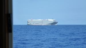 A car carrier passes close by