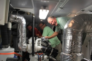 Bradley, Atle, and Randy in Argo's engine room