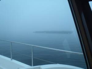 The fish farm obscured by fog