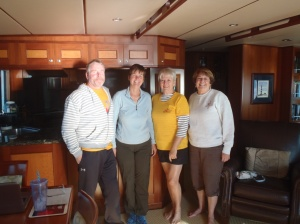Bradley and Kathy with Nancy and Kathy who rowed out to meet us