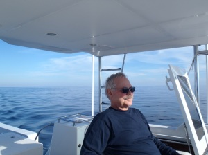Gary enjoys the flybridge with calm seas