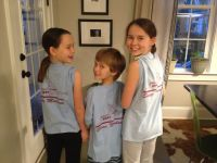 Liesl, Calvin, and Claudia show off their Shear Madness shirts