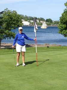 Kathy at the Bluenose Golf course in Lunenburg with Shear Madness at anchor