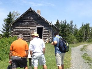 Visiting the log house at Iona
