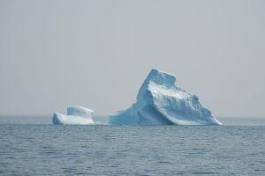 Iceberg - tug towing a barge?