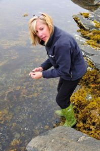 Marci gathers mussels (Photo by Steve D'Antonio)