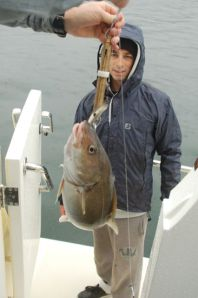 Matt with his biggest catch - a 10-pound cod