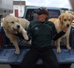 Reg and his dogs in Makkovik