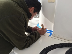 Sergio removes old (white) caulking