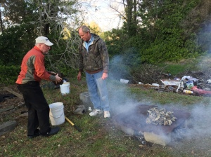 Bradley and Steve start some oysters roasting