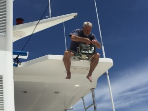 Richard (our new crew) changes a light bulb in deck light