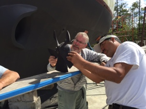 Bradley and Sergio inspect a bow thruster prop