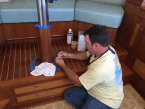 Cory from Crystal Coast Interiors preps pilothouse pedestal