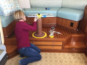 Cathy from Crystal Coast Interiors applies varnish