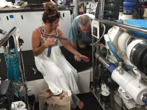 Beth from Crystal Coast Interiors installs engine room carpet