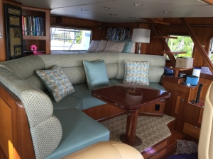 New Pilothouse settee and bunk coverings with re-finished table