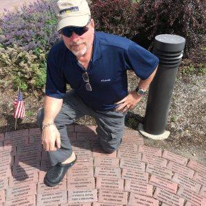 Bradley with his father's commemorative brick