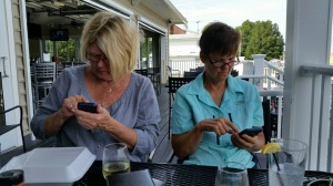 Kathy and Cyndy at lunch in Solomons, MD. No, we are NOT texting each other!