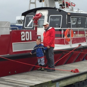 Grandpa and Tyler with the fireboat