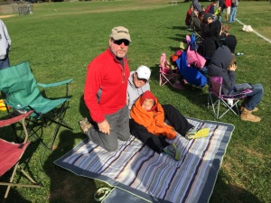 Grandpa Bradley with Margy and a cold Austin at Tyler's soccer game