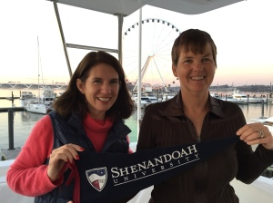 2015-12 President Tracy Fitzsimmons with the Shenandoah Flag at National Harbor