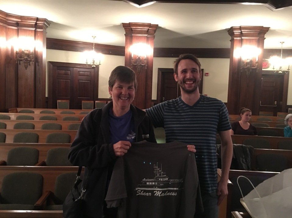 Presenting a Shear Madness T-shirt to Jesse, director of the Charleston Shear Madness