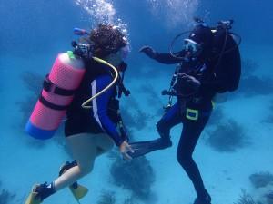 Bradley helps Katie practice buoyancy control