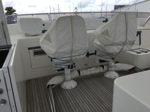 Tender's bimini top (awning) stored under chairs, chair covers secured with tie downs