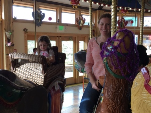 Sophie and mom Vicky ride the Carousel of Happiness